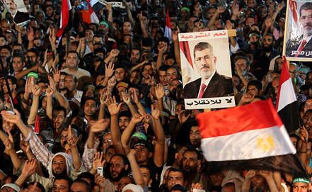 Акция в поддержку экс-президента Египте М.Мурси в Каире. Фото EPA/ИТАР-ТАСС
