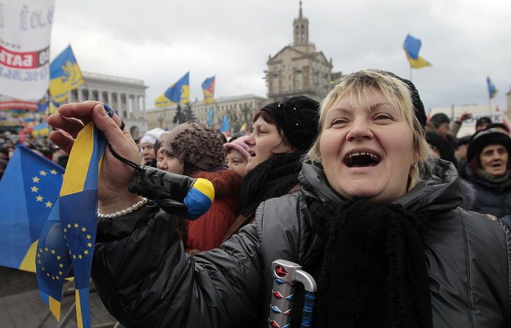 A pro-European Union activist shouts a slogan during a rally in Independence Square in Kiev