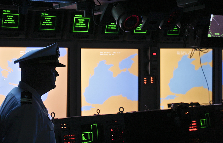 US Navy officer looks on at the weapons control deck of the USS Monterey, a war ship carrying AEGIS class ballistic missile defense technology, in the Black Sea port of Constanta, Romania